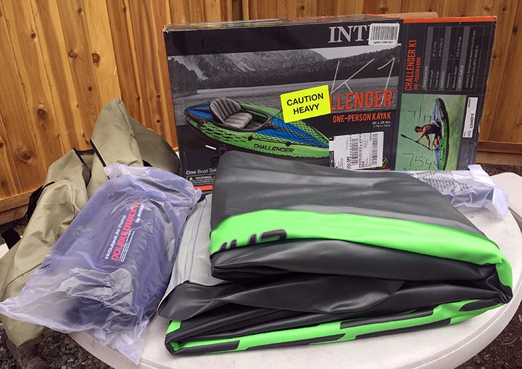 Intex Challenger K1 Inflatable Kayak vs Advanced Elements Inflatable Lagoon Kayak. The Intex box includes a carry bag; the kayak itself, which has two air chambers; two seat cushions (seat and back rest); a foot rest cushion; and a paddle which you clip together