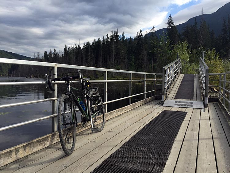 Cycling near Buntzen Lake, British Columbia, Canada. My bike on the floating bridge over Buntzen Lake, on the trail to Buntzen Lake