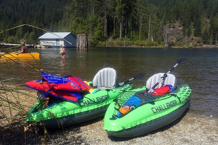 Review and Assembly of the Intex Challenger K1 Kayak – the Best Lightweight, Budget, Inflatable Kayak for RV Living. Here are our two Intex Challenger K1 kayaks on the beach, with the life jackets we bought to go with them