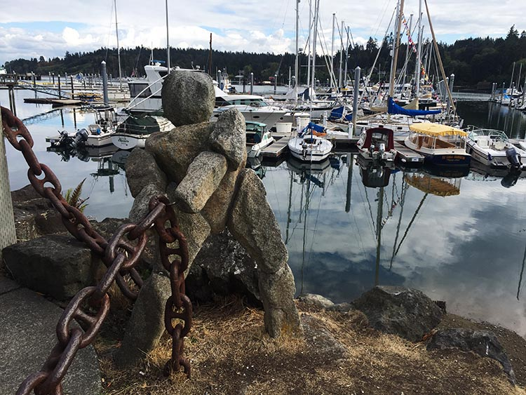 What Can You Do When Your RV is Having Repairs? Down by the water on Bainbridge Island, someone has erected a lot of interesting stone art, including this stone worker