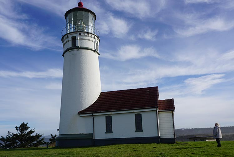 Our Experience of RV Camping at Beverly Beach and Humbug Mountain State Parks, Oregon Coast. Maggie admiring Cape Blanco Lighthouse