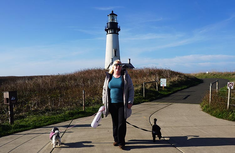 Our Experience of RV Camping at Beverley Beach and Humbug Mountain State Parks, Oregon Coast. Maggie and the dogs at Yaquina Head Lighthouse. Notice how Billy (on the right) is behaving well, while Ripley is attempting to walk in the opposite direction. Typical ...
