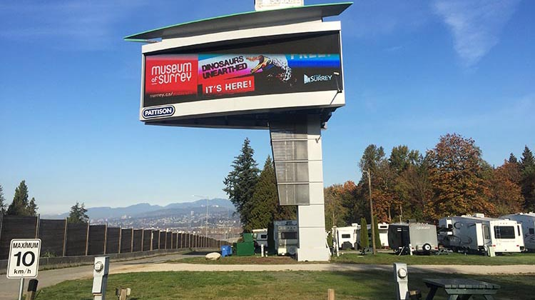 Here is the gigantic billboard, and the highway is just to the left of that concrete wall