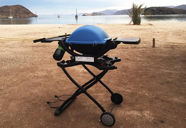 When we were camping rough on Santispac Beach in Baja California Sur, the Weber stand was invaluable, as there were no picnic tables