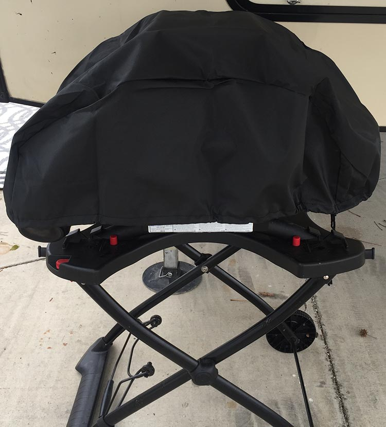 The barbecue cover I bought for my Weber. It fits over the barbecue nicely, with the side tables folded in