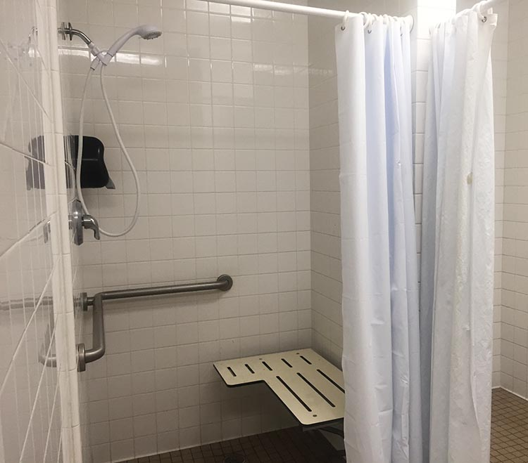 Review of A Country RV Park, Bakersfield, California. The disabled shower is the biggest and most comfortable showering area. The other showers are minimalist, and it is very challenging to find a place to put your toiletries. It is also impossible to keep your clothes dry, unless you put them on a chair outside the shower stall