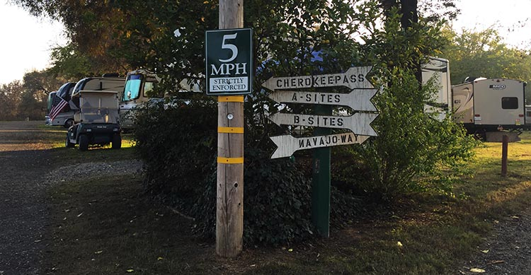 Review of Merced River RV Resort, Delhi, California. Sign posts on the roads inside the Merced River RV Resort