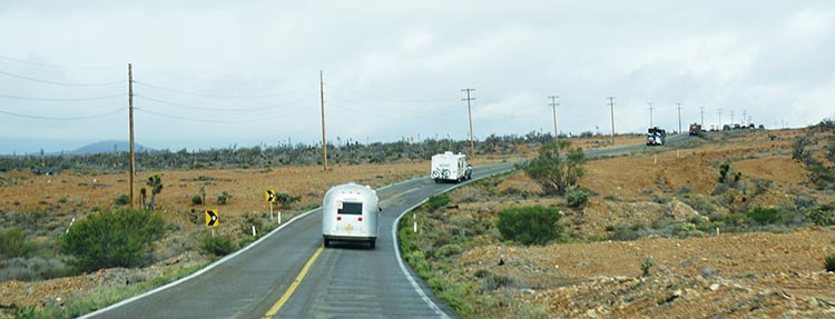 Following the convoy on the road. Notice the almost non-existent shoulders, which make towing a rig very challenging