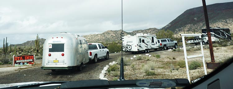 Our caravan of RVs heading down the horrible dirt road to Rancho Santa Inez