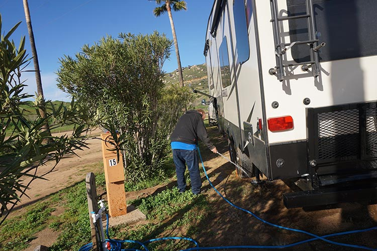 Our Return RV Caravan Trip from Baja California: Santispac Beach to Tecate. Joe took the opportunity to clean some of the mud off the truck and the Denali.