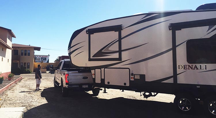 Here's Jerry battling to park our Denali in the very tight Malarrimo RV park. This particular spot proved to be impossible, due to the close proximity of the building on the left