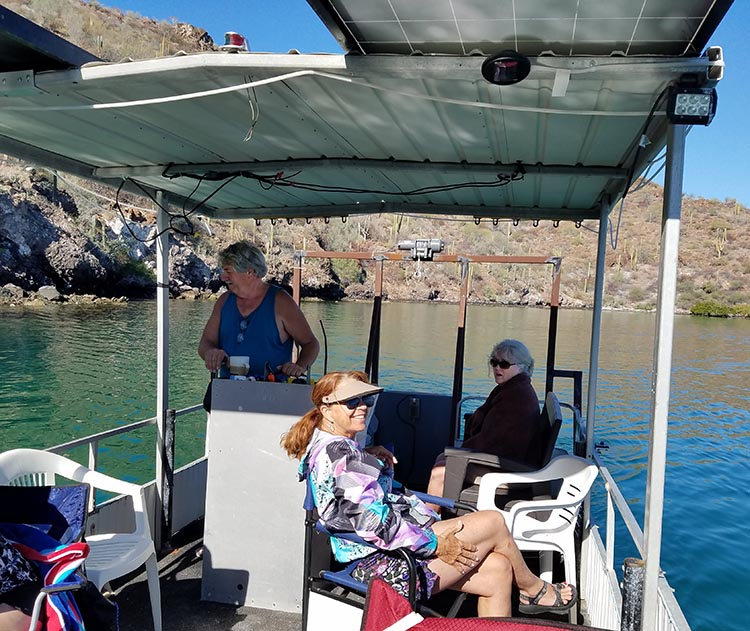 Here's Jerry, Nancy and Kathy on Jerry's boat. Photo by Juli Cooley