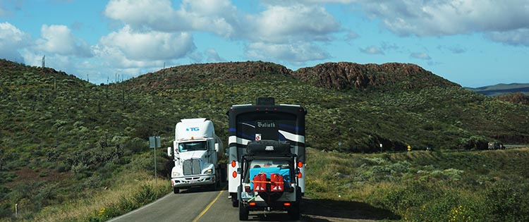 Our Return RV Caravan Trip from Baja California: Santispac Beach to Tecate. Here is an 18-wheeler going past Goliath (Joe and Kathy). That rig is 9 foot wide, so that was always a tight squeeze! Notice how far to the right Goliath is