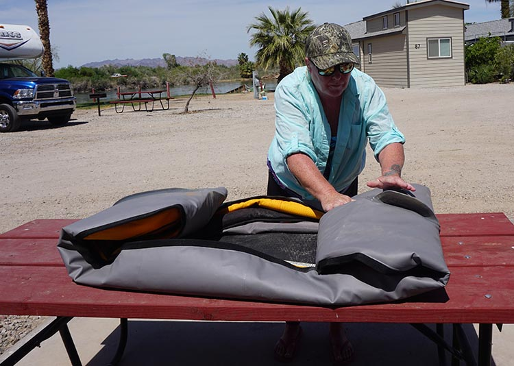 Here I am folding up our Advanced Elements Lagoon Kayak