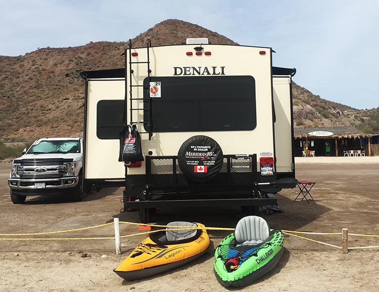 Intex Challenger K1 Inflatable Kayak vs Advanced Elements Inflatable Lagoon Kayak. Here are both of these kayaks, parked on the beach in front of our Denali on Santispac Beach, Baja California Sur