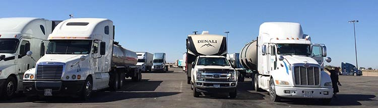 We met Vicky and Darryl at a gas station just north of the Baja California border. Here we are, parked between the 18 wheelers