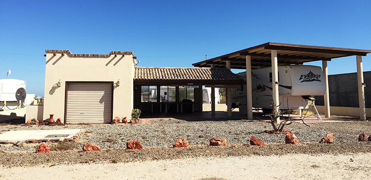 Here is a typical habitation at El Dorado Ranch. This one is in a mixed use area, where you are able to have houses and/or RVs. This one is on the minimalist side. Many are much more lavish
