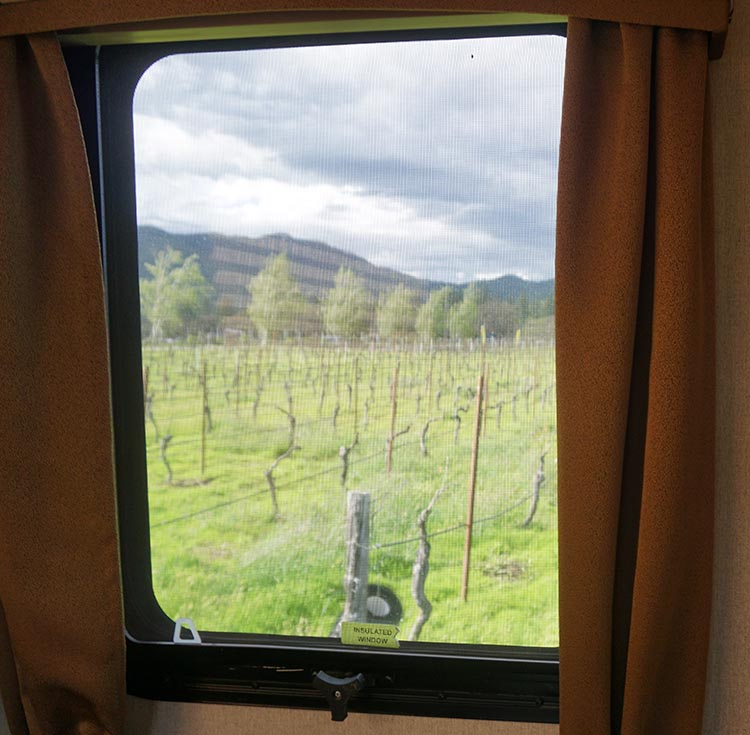 How to Get Free RV Camping with Harvest Hosts. From our bedroom window at LongSword Vineyards, we looked directly out onto the vineyards