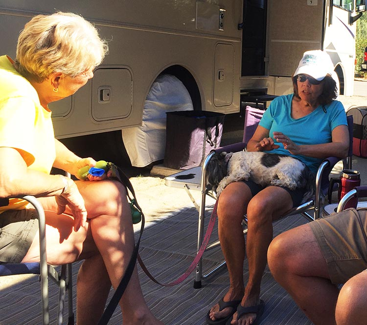 Ripley loves RV living, mainly because she makes so many new friends. Here she is with our friends Marilyn and Andrea, sitting on Andrea's lap