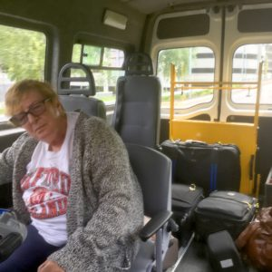 Trip - Di and luggage in the bus
