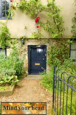 Trip - Cottage entry with low doorway. Inset: sign above doorway
