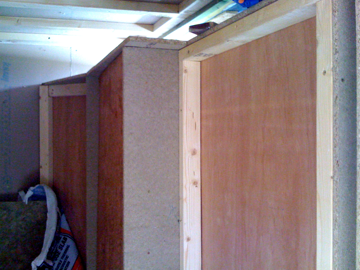 Control room bass trap, viewed from the doorway. Rockwool panels will hang in front of the plywood, and hessian will be stretched over the whole thing.