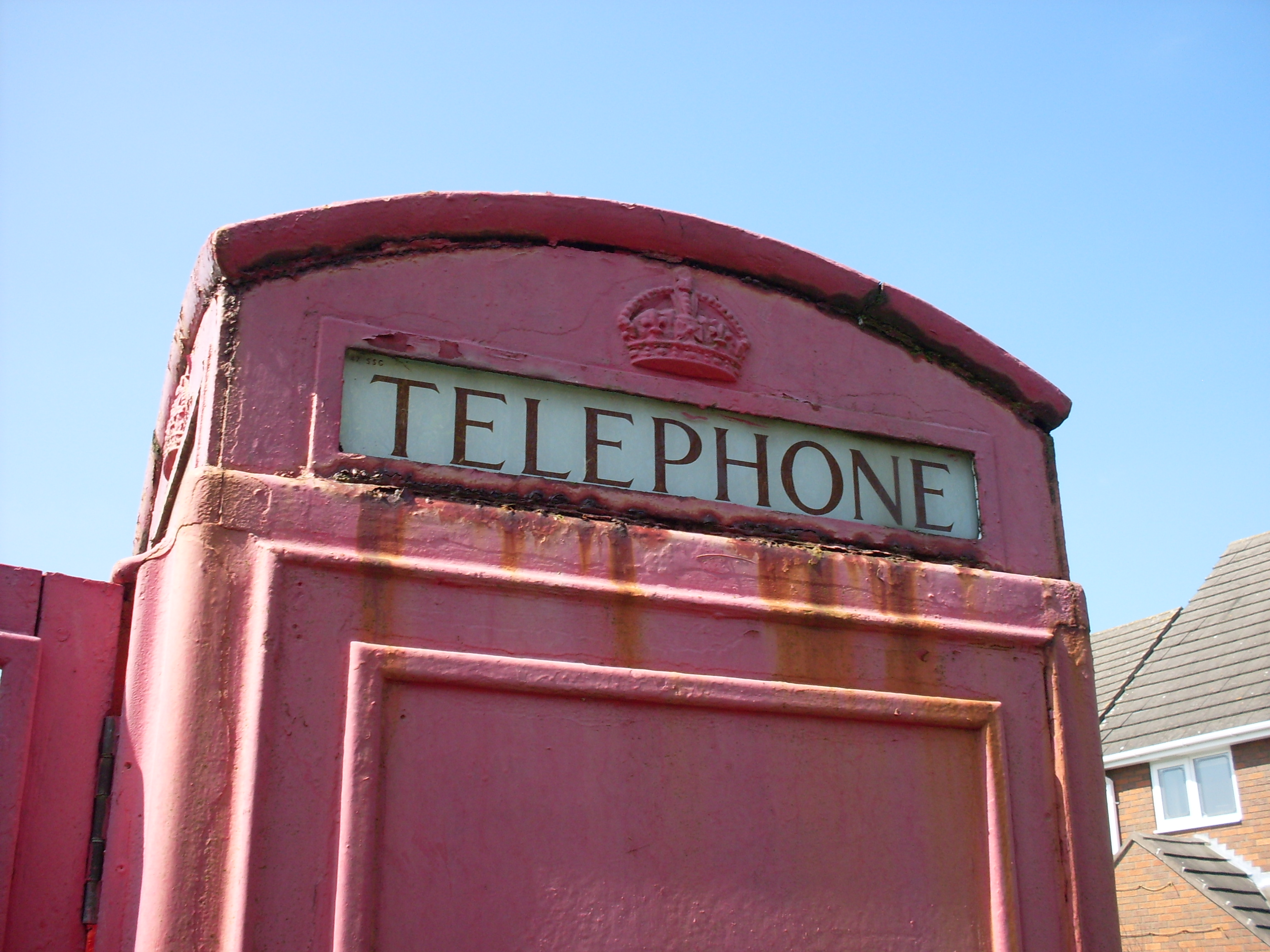 One of the backlit 'Telephone' panes, showing how bad the exterior rust has become over the years.