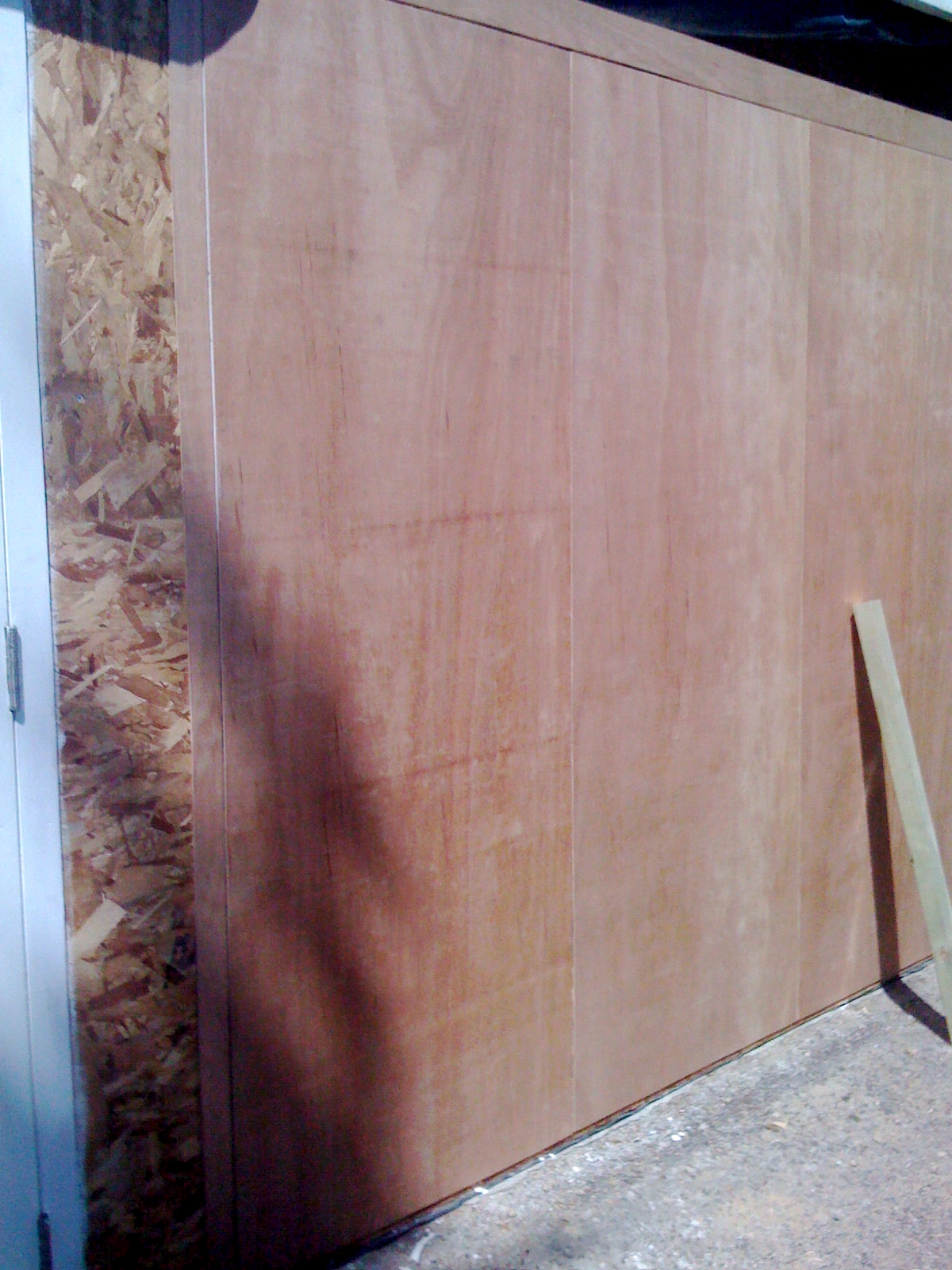 Exterior wall with bare plywood covering