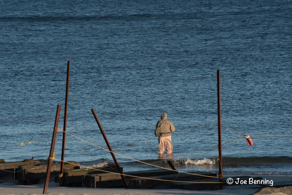 A fisherman between the Posts and in the Water