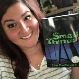 Ashley Price holding her copy of Small Things.