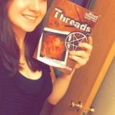 Burgundy Wisrock with her copy of Threads