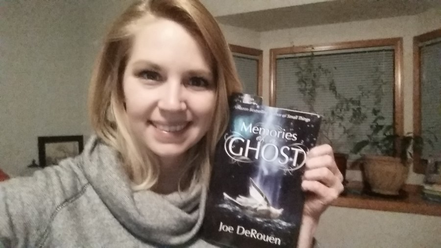 Hannah Roberts with her copy of Memories of a Ghost.