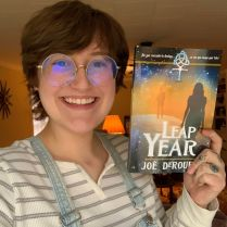 Hannah Hufffmaster-Bass with her brand new copy of Leap Year