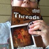 Jude Frazee dining on Threads.