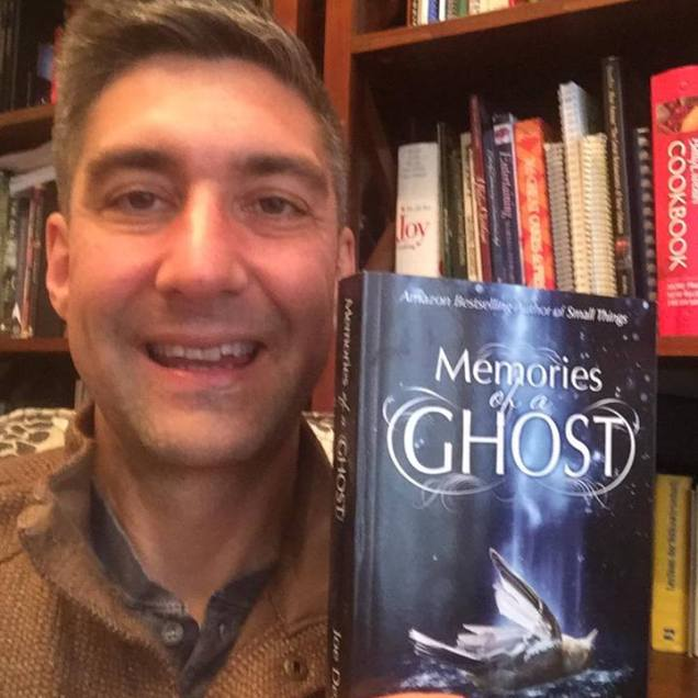 Patrick Bowman with his copy of Memories of a Ghost