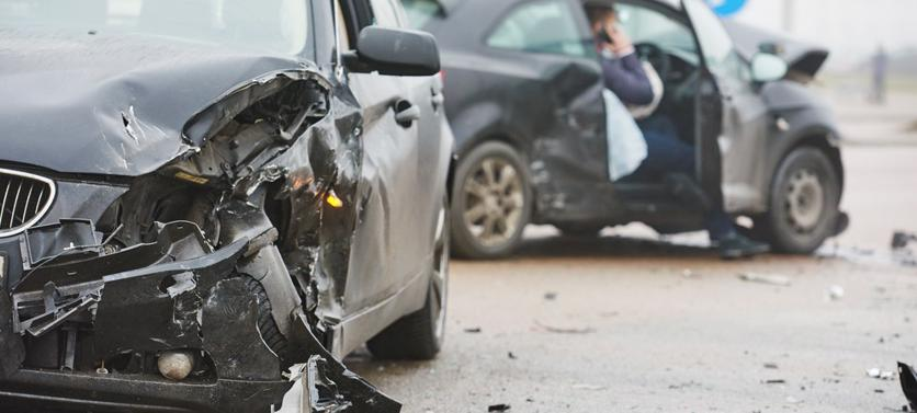 This image shows two cars damaged after a car accident.