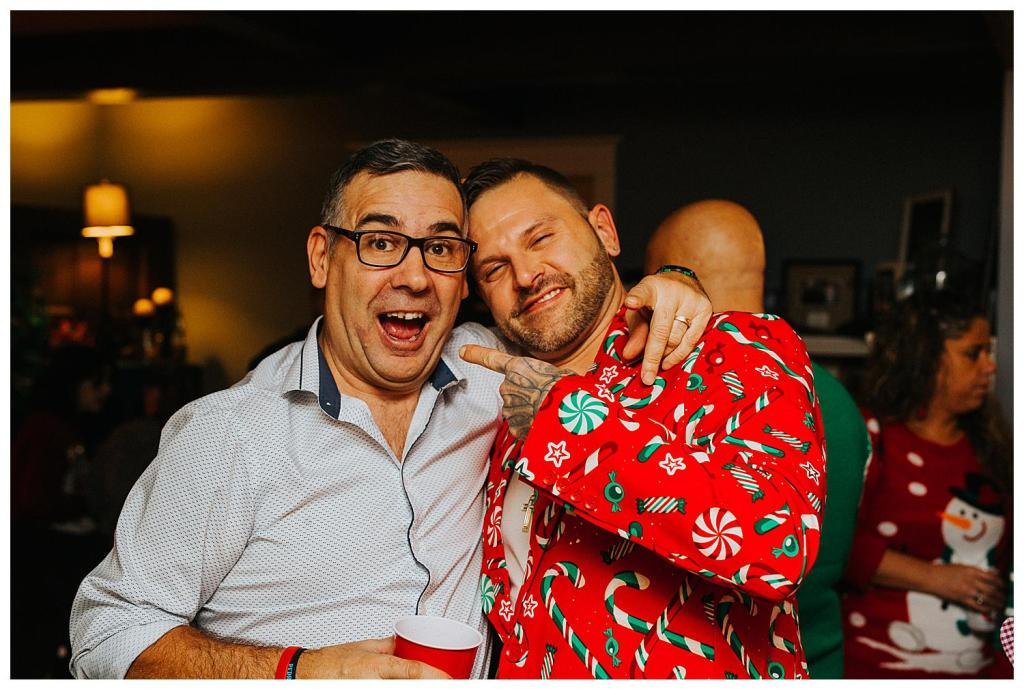 Groom with a wedding guest at a Christmas Elopement