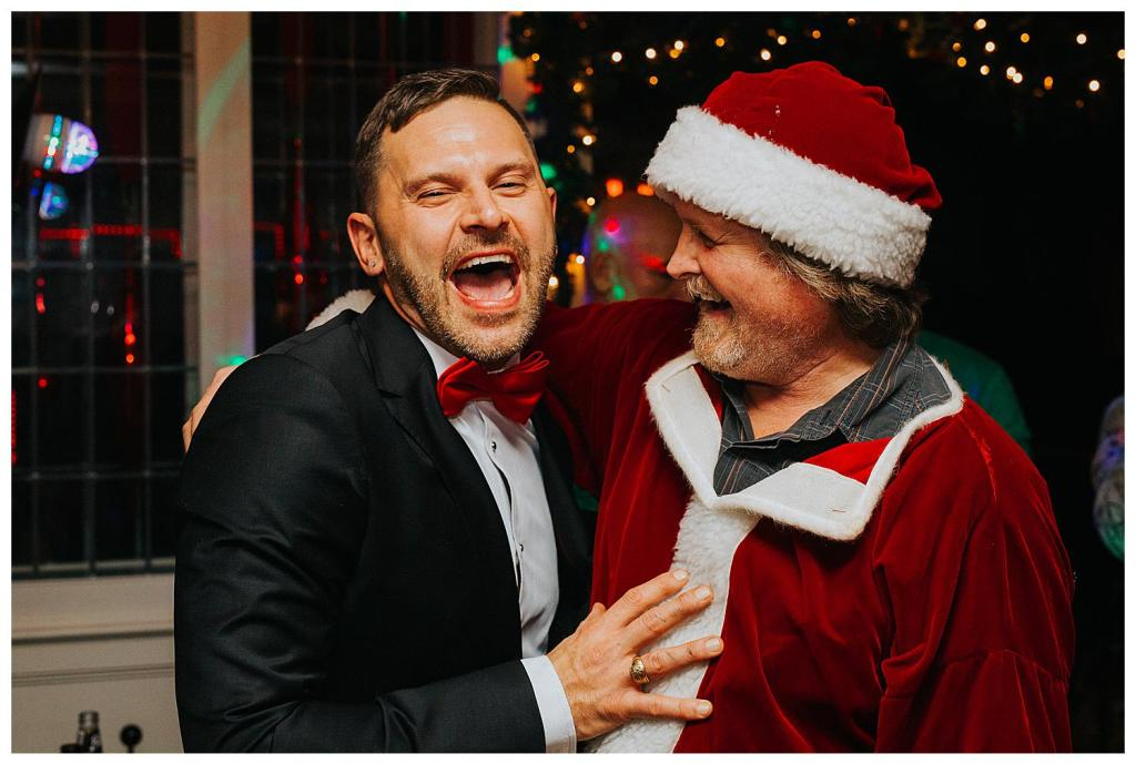 Groom with Santa at a Christmas Wedding