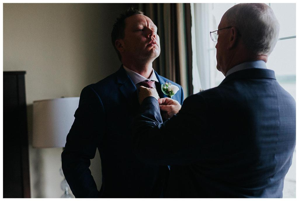 The grooms soon to be father in law helping him with the tie | wedding inspiration | Getting ready