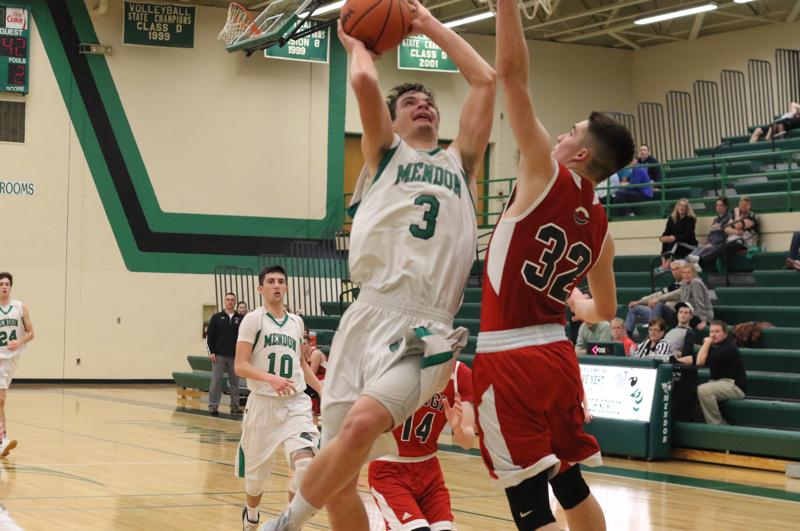 Video: Mendon uses early run to put away Magi in boys basketball