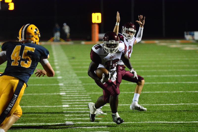 Kalamazoo Central gets first win of Carlton Brewster era, beats Portage Central 30-14
