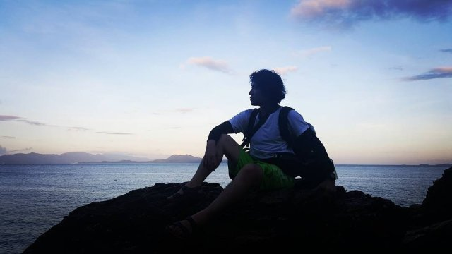 Me during sunset in Aplayang Munti, Puerto Galera. Traveled here using a motorbike with John of Arkipelago Divers. Photography by John of Arkipelago Divers.