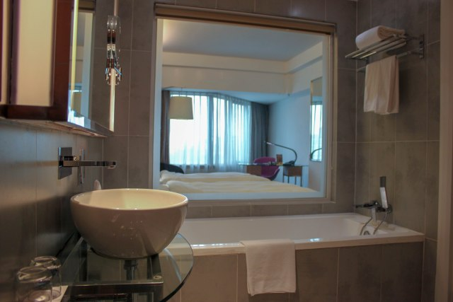 Toilet and bath of a Deluxe Room at the Pullman KL Bangsar Hotel