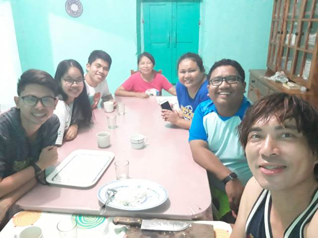 Photo-op with Tita Neyala and fellow backpackers at the dining area of Neyala's Homestay in Sabtang, Batanes