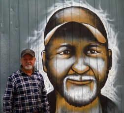 This mechanic let the group use his garage to store supplies for the mural, so Joel painted a portrait of him on the front of his business to show his thanks.