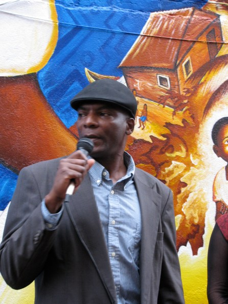 Afro-Colombian activist Marino Cordoba speaks at the inaugural event, telling of his experience being shot by right-wing paramilitary members in Colombia, after which he came to US as a political asylee.