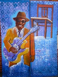 """The """"Godfather of Go-Go,"""" the late local legend of DC Chuck Brown, featured in a mural created by students in Joel's after-school program."""