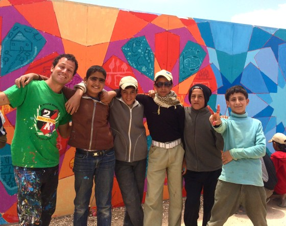 We painted with the famous wheelbarrow boys of Za'atari who smuggle goods into the refugee camp. They painted about what they miss most about their homes in Syria.