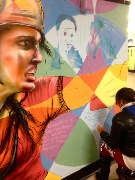 Writing messages in the mural.