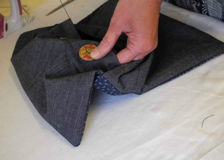 sewing the buttons on